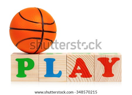 Wooden blocks arranged in the word PLAY and small basketball ball - isolated on white background - stock photo