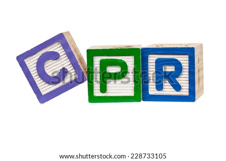 Wooden blocks forming the letters CPR isolated on white background  - stock photo