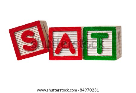 Wooden blocks forming the letters SAT isolated on white background