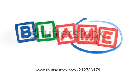 Wooden blocks forming the word BLAME with the word ME circled  - stock photo
