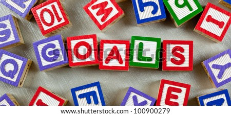 Wooden blocks forming the word GOALS in the center