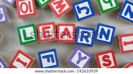 Wooden blocks forming the word LEARN in the center  - stock photo