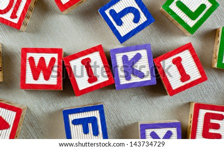 Wooden blocks forming the word WIKI in the center  - stock photo