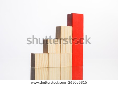 wooden blocks in stair steps with red ones showing growth - stock photo