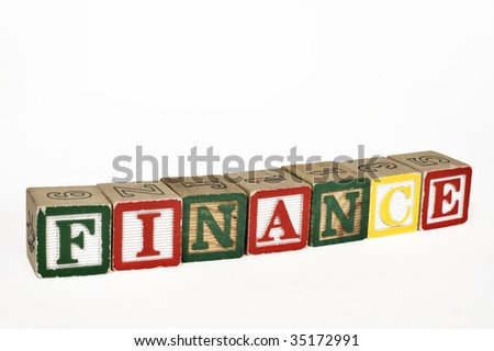 Wooden blocks laid out to spell finance