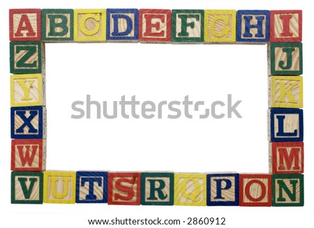 wooden blocks of the alphabet in a frame to be used as a background