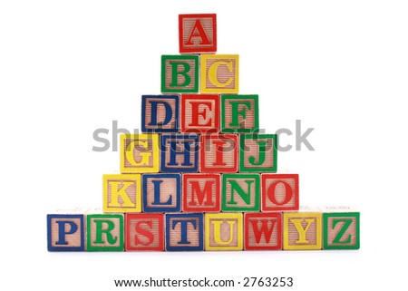 wooden blocks with colorful letters isolated on white