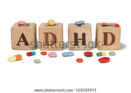 Wooden blocks with letters ADHD and pills