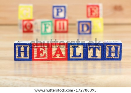 Wooden blocks with letters. Educational toy concept - children health care. - stock photo