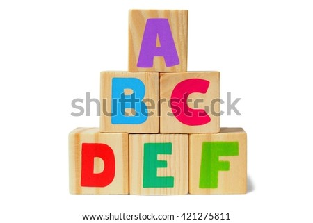 Wooden blocks with letters on white background - stock photo