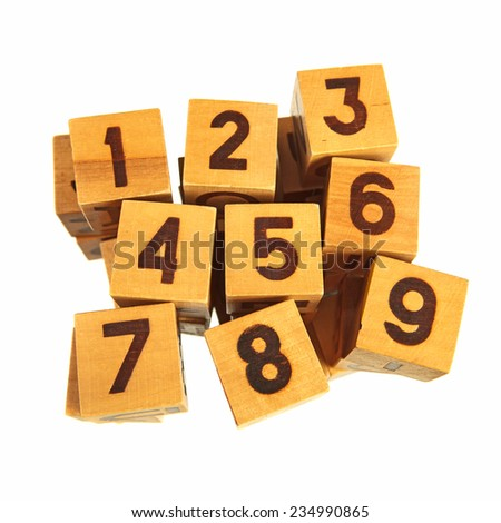 Wooden blocks with numbers from one to nine over white background - stock photo