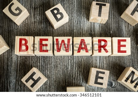 Wooden Blocks with the text: Beware - stock photo