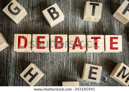 Wooden Blocks with the text: Debate - stock photo