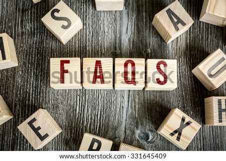 Wooden Blocks with the text: Faqs - stock photo