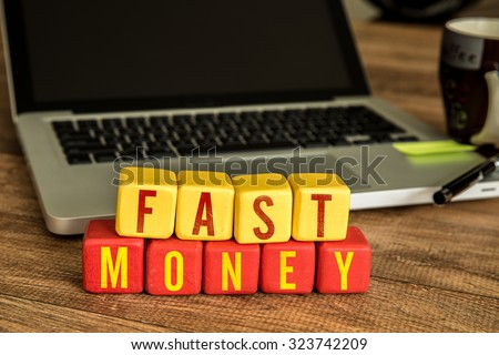 Wooden Blocks with the text: Fast Money - stock photo
