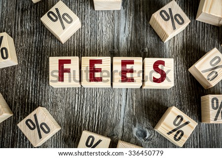 Wooden Blocks with the text: Fees - stock photo