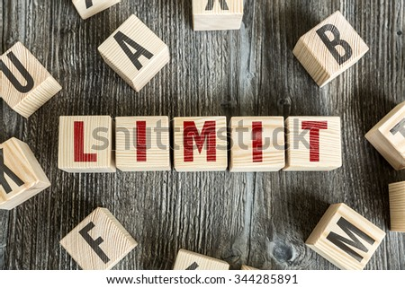 Wooden Blocks with the text: Limit - stock photo