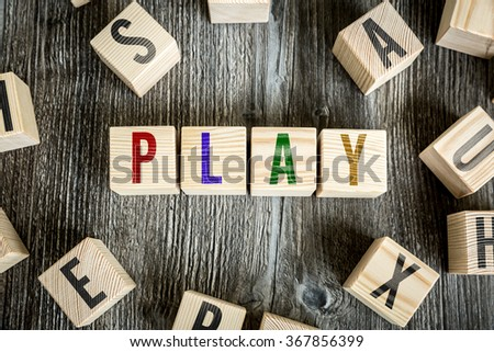 Wooden Blocks with the text: Play - stock photo
