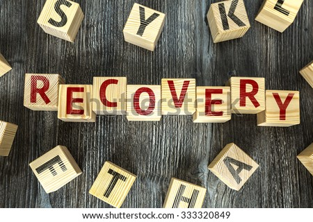 Wooden Blocks with the text: Recovery - stock photo