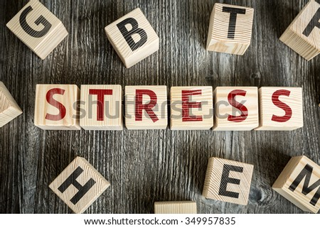 Wooden Blocks with the text: Stress - stock photo