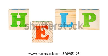 wooden blocks with the word help isolated on a white background