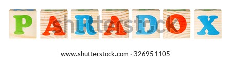 wooden blocks with the word paradox isolated on a white background