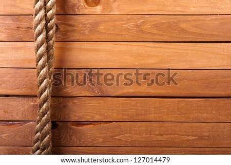 Wooden board background with rope - stock photo