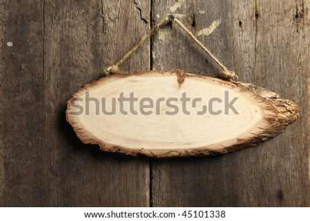 wooden board hanging on the wall - stock photo