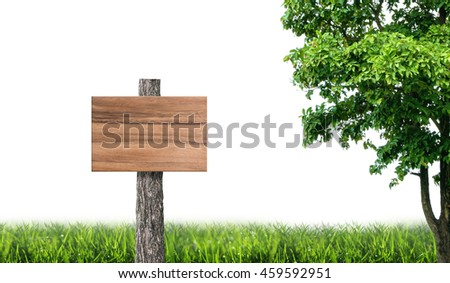 Wooden board in green meadow and tree on white background.