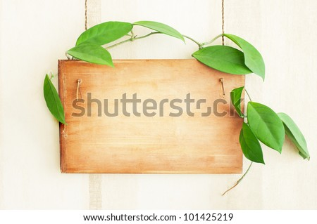 Wooden board on the wall - stock photo