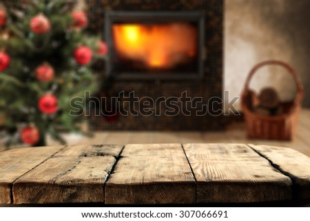 wooden board place and xmas tree  - stock photo