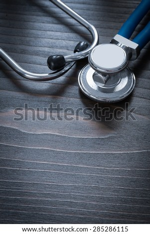 Wooden board with diagnostic medical stethoscope medicine concept  - stock photo