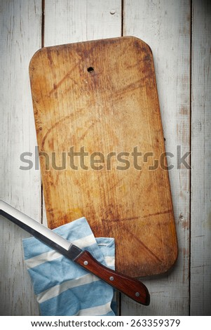 Wooden Board with knife and napkin - stock photo