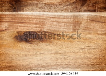 Wooden board with tree branch and vignetting on the corners - stock photo