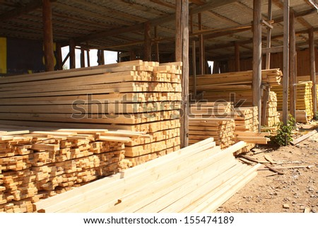 Wooden boards in a warehouse of building materials - stock photo