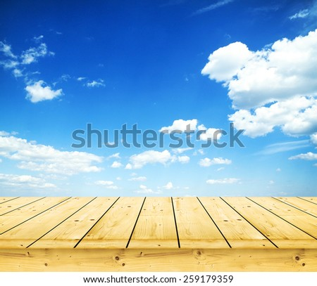 Wooden boards over a blue sky - stock photo