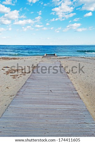 wooden boardwalk in Stintino, Italy - stock photo