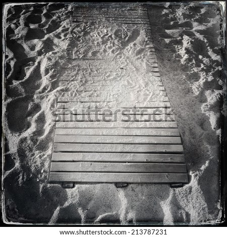 Wooden boardwalk in the sand. Black and wet plate collodion photo.