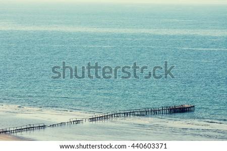 Wooden boardwalk on the beach - stock photo