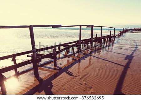 Wooden boardwalk on the beach.Instagram filter. - stock photo