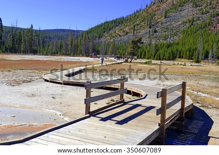 Wooden Boardwalks on the geothermal areas of Yellowstone National park, protect both visitors and the fragile volcanic environment of microorganisms that create the colorful mats near the hot springs