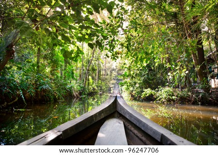 Wooden boat cruise in backwaters jungle in Kochin, Kerala, India - stock photo