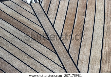 Wooden boat deck on a sunny day - stock photo