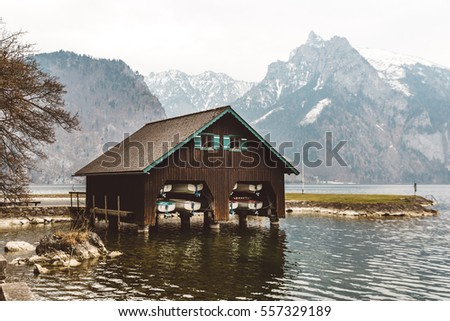 Wooden boat house on the shore of the Lake Traunsee in Salzkammergut, Austria