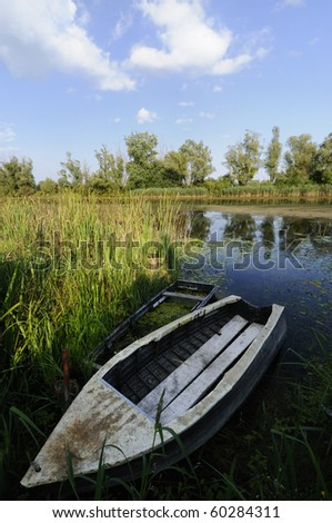 Wooden boat in the lake - stock photo