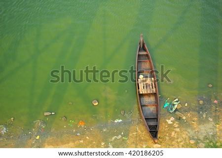 Wooden Boat in The Lake at U Bein Bridge, Myanmar - stock photo