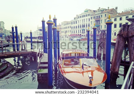 wooden boat in Venice, Italy. Processed for vintage tone effect. - stock photo