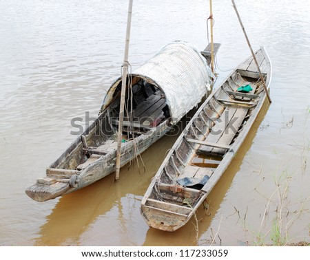 wooden boat on Mekong river, Thailand - stock photo