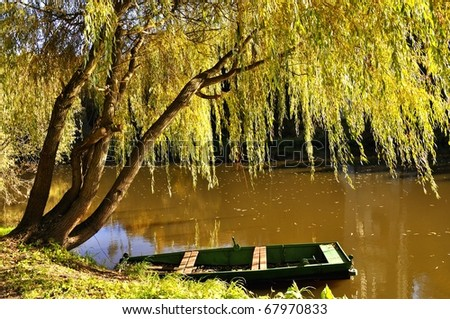 Wooden boat on the river Luznice - stock photo