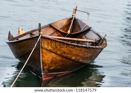 Wooden boat on water - stock photo